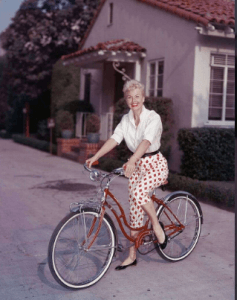 Doris Day poses on a red Schwinn bicycle, late 1950s. (Photo by Hulton Archive/Getty Images)